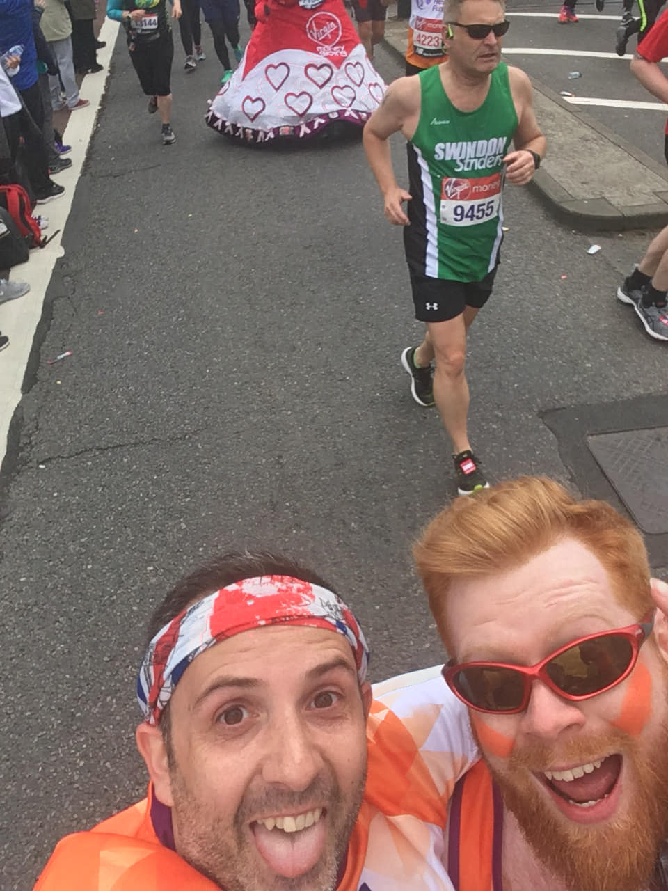 Me and Paul both smiling in front of other runners