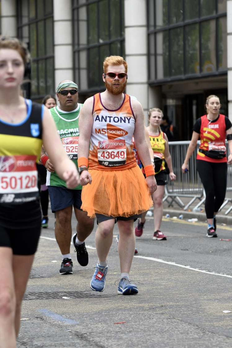 Me walking in my orange tshirt and tutu looking very tired